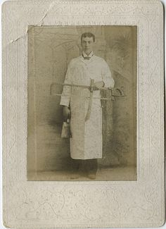 A classic butcher's ensemble complete with knife, saw and cleaver.