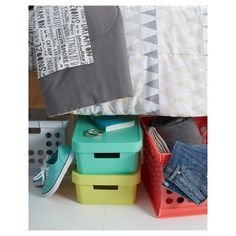 • Durable plastic<br>• Lift-off lid<br>• Integrated handles<br>• Stackable<br>• Sturdy construction<br><br>The Medium Decorative Storage Bin from Room Essentials offers stylish storage thanks to its bright, youthful color. Great for organizing, this storage box stacks so you can make the most of your space.
