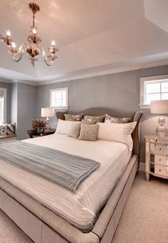 *VERY* similar to my bedroom layout.  Bed flanked by small, high windows with large window to left side.