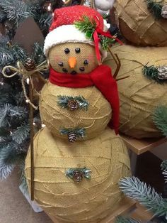 Wrap styrofoam balls in burlap to create a rustic snowman.