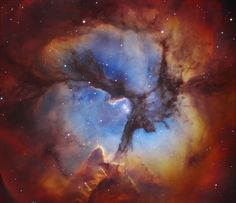 In the Center of the Trifid Nebula -  Clouds of glowing gas mingle with dust lanes in the Trifid Nebula, a star forming region toward the constellation of the Archer (Sagittarius). In the center, the three prominent dust lanes that give the Trifid its name all come together. Mountains of opaque dust appear on the right, while other dark filaments of dust are visible threaded throughout the nebula.