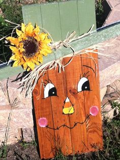 2 ft x and x scarecrow with flower and snowman reversible, stained and hand painted with protective coat of polyurethane to prevent weather damage Fall Wood Crafts, Halloween Wood Crafts, Christmas Wood Crafts, Diy Halloween Decorations, Fall Halloween, Christmas Signs, Wood Scarecrow, Scarecrow Face, Scarecrow Crafts