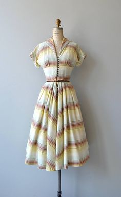Vintage 1950s dress, quite Claire McCardell inspired, cotton with tan, yellow, white and mint stripes, loop button front, cuffed short sleeves, open collar, seamed empire bodice, fitted waist, full skirt and coordinating belt. --- M E A S U R E M E N T S --- fits like: extra small bust: 34-36 waist: 25 hip: free length: 45 brand/maker: n/a condition: excellent to ensure a good fit, please read the sizing guide: http://www.etsy.com/shop/DearGolden/policy ✩...