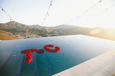 Photography: onelove photography - www.onelove-photo.com  Read More: http://www.stylemepretty.com/2015/04/03/red-pink-malibu-mountaintop-wedding/