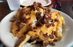 Bacon and cheese over hand-cut fries [OC] [1067x695]