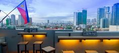 woman enjoying in one of the best rooftop bars in manila