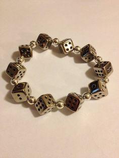 7 in. Stretch Silver Dice Bracelet. $8.00, via Etsy.