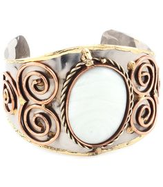 Gorgeous cuff-style bracelet designed with a gold-trimmed, hammered body, ornately decorated with an elliptical...
