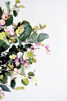 These gorgeous snowberries would add just the right amount of color to a drab room!