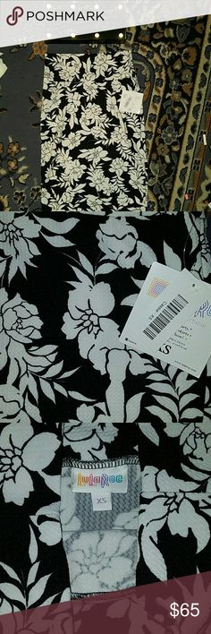 Lularoe Cassie floral skirt*HTF* X small Well ladies and gentlemen this here is the beautiful Cassie skirt and a black and white floral pattern which was very hard to come by and I didn't want to let go because I know a few tricks of the trade and this can be worn as a beautiful scarf it can be worn as a top a very short dress or of course a pencil skirt so you really can get your bang for your buck and this is a wardrobe staple this is an extra small but a very stretchy material. This Is…