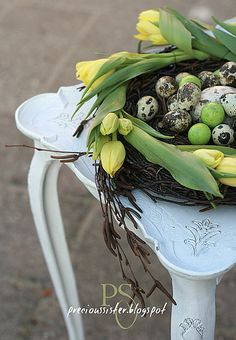 Nest with tulips. This would be cute for Easter if you put easter eggs in the nest.