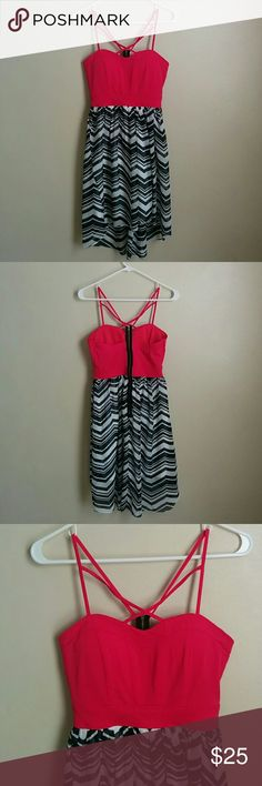 Charlotte Russe Corset High Low Dress Hot pink corseted top with black and white chevron high low skirt. Dress by Charlotte Russe in a size medium. The corseted top stops at the rib cage. Dress length from top hem to bottom hem in the front is 24 1/2 inches and back length is 29 1/2 inches. Charlotte Russe Dresses Midi