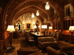 Hearst Castle Library/office/study, notice the artwork on the beams, and the glass covering the collection of rare books.