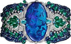 Cartier Étourdissant High Jewelry Bracelet. Platinum, opal, sapphires, emeralds, Paraiba tourmalines, diamonds.