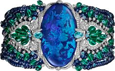 Cartier Étourdissant High Jewelry Bracelet. Platinum, opal, sapphires, emeralds, Paraiba tourmalines, diamonds.