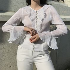 """Vintage Austrian blouse in white. Blouse is fully pleated. Flounce sleeve. Transparent fabric. Very romantic and elegant piece. Perfect for summer.  MEASUREMENTS lying flat Shoulder to shoulder 40cm, Chest 47cm, Waist 42cm, Length 58 cm, Sleeve length 58cm. 100% Polyester. Made in Austria. Condition is excellent. Tag reads Size S. Fits Size XS-S. Model Size S, model height 1,78m/5'10""""  PRICE EUR 52. FREE shipping. DM country to purchase. Donate To Charity, Ruffle Blouse, Romantic, Free Shipping, Model, Sleeves, Vintage, Tops, Fashion"""