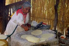 Making tortillas on the comal (clay griddle). | Could almost be mi abuelita's kitchen!