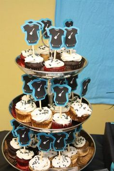 Onesie topped cupcakes at a Boys Rock Baby Shower! See more party ideas at CatchMyParty.com! #partyideas #babyshower