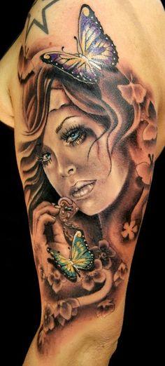 woman and butterflies tattoo