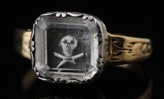 Rare gold mourning ring with a rectangular bezel set with a crystal covering a piece of dark hair with skull, painted in white. The hoop adorned with floral scrolls. Good condition. price on application Ref: Charles Oman, British Rings 800-1914, 1974. (Victoria and Albert Museum) 00 EUR. Lot Sold11,250 EUR http://elogedelart.canalblog.com/archives/cabinet_de_curiosites/p50-0.html