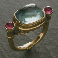 Saw this on pinterest somewhere, but can't find the original source.  Looks like a museum piece!  Supposedly Aquamarine...maybe, maybe not (looks cracked) but those are rubies!