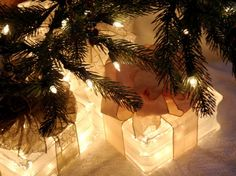 "Outside Christmas decor:  lighted glass block ""packages"" under a tree."