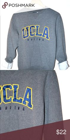 Casual UCLA Official Grey Pullover Sweater Insignia pullover UCLA Sweater with ribbed neckline. Comfy and retro style pullover with fleece inside. #uclabruins #vintage #grey #retro Casual UCLA Official Grey Pullover Sweater UCLA Sweaters Crew & Scoop Necks
