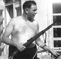 Amon Goeth on the balcony of his villa at Plaszow concentration camp before selecting random prisoners to shoot