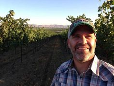 Robert Smasne stands in Otis Vineyard north of the Yakima Valley town of Grandview, Wash. Smasne grew up nearby and now is one of Washington's top winemakers. He recently opened a tasting room at the Vintners Village in Prosser.