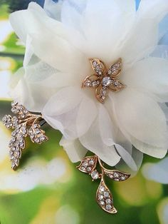 Bridal hair flower and separate leaves on bobby pins...create a unique look for your wedding day hair style.  By One World Designs Bridal Jewelry.