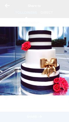 """Boldness be my friend."" -William Shakespeare   Made by Anna Carlson,  Cake Conservatory  www.cakeconservatory.com   Black and white stripes, a gold bow, and red roses make this cake a bold statement at any wedding or party."