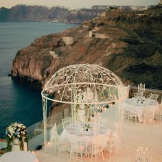 There's no prettier setting than this! This couple chose a reception venue overlooking the Aegean sea in Santorini, Greece. Photo: Anna Roussos/ The Knot Blog