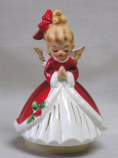 Gorgeous Josef Originals Christmas Angel Music Box--have a similar Christmas angel.  Mine is not a collectible---but they don't have to be to add a touch of charm to Christmas.