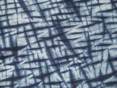 This indigo Shibori cotton features a dynamic criss cross pattern. The hash marks cross the fabric on a diagonal creating movement. It is a lively