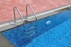 Considering glass tiles for your pool? Here are five things to keep in mind when hiring a contractor to install tile in your swimming pool.