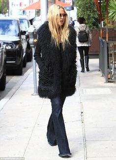 Signature style! The 45-year-old celebrity stylist went with a bohemian chic style in over...