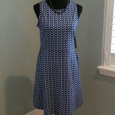 NWT! NY&C Sleeveless Dress Adorable sleeveless dress with pockets. Flares at the waist. Blue, black amf white geometric design. 100% Cotton. New York & Company Dresses