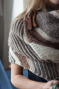 The garter stitch fabric utilizes artful colour shifts throughout its length, creating dynamic and gorgeous contrast whether it lies flat or whirled around you like a warm, gentle hug. Find this shawl pattern at LoveKnitting!