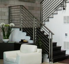 modern-grey-polished-iron-stair-railing-contemporary-design-with-black-hardwood-treads-above-white-leatherette-armchair-and-lovely-flower-centerpiece-as-well-as-wrought-iron-fence-gate-and-front-gates-618x571.jpg (618×571)