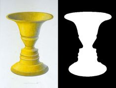 Rubin's vase is an optical illusion in which the negative space around the vase forms the silhouettes of two faces in profile, a well-known example of figure-ground reversal by emphasizing that negative space