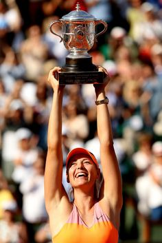 Maria Sharapova of Russia poses with the Coupe Suzanne Lenglen trophy