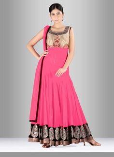 Add richer looks to a persona with this pure georgette anarkali suit. This pretty dress is showing some fantastic embroidery done with cut dana, kasab work, moti work, resham work and velvet patch com...
