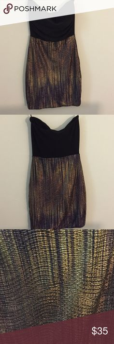 Symphony strapless dress. Small Symphony strapless club dress. Small. Very sparkly. Gold bottom mesh, black top. Padded cups. Hardly worn. Symphony Dresses Strapless