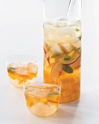 """{Flipping delicious!)Mango-Peach Sangria  Contributed by John Besh  TOTAL TIME: 30 MIN SERVINGS: 4          Add to Favorites    John Besh of Restaurant August in New Orleans serves this lightly sweet, fruity white-wine sangria over plenty of ice cubes. """"Use Viognier—it has a nice balance of fruit and acidity,"""" he says.  Plus: 20 Lessons from Chefs      © Quentin Bacon  Recipe: Mango-Peach Sangria  MAKE-AHEAD  1/3 cup sugar  1/3 cup water  1 cup Grand Marnier  1 bottle Viognier  1 mango…"""