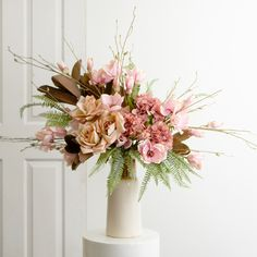 Stunning flower arrangement in blush and dusty pink hues