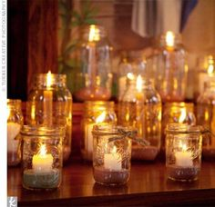 i love candles && i love mason jars. i think having multiple jars in the center of the table would be beautiful.