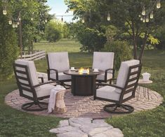 Castle Island Dark Brown Round Fire Pit Table, Signature Design by Ashley(Aluminum), Outdoor Décor Round Fire Pit Table, Round Outdoor Table, Fire Pit Coffee Table, Outdoor Fire Pit Table, Fire Pit Backyard, Desert Backyard, Patio Ideas With Fire Pit, Backyard Retreat, Outdoor Seating