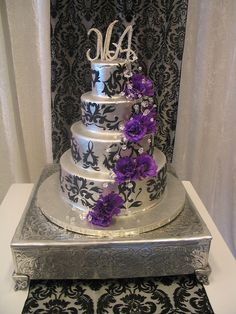 4-tier Wicked Chocolate wedding cake iced in silver chocolate ganache decorated with black fondant damask, purple lisianthus & 3D bling monogrammed initials by Charly's Bakery, via Flickr