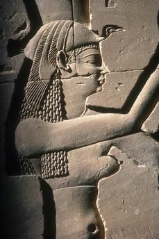 detail of relief showing anthropomorphic image of the cobra goddess Wadjet - one of the Two Ladies as the dual patron deities of the unified country of Lower and Upper Egypt crowning the king  -  Edfu, Horus Temple