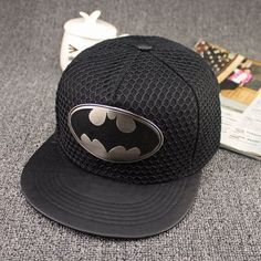You don't have to be Batman to have a cool hat. Buy this snapback cap now and make all of your Batman fan friends jealous! - Have the coolest Batman cap around - Geometric Design - Adjustable strap fo